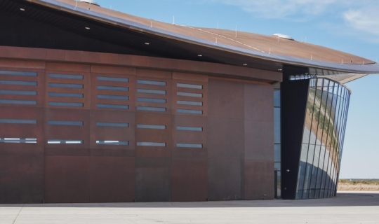 View of the massive Solanum-clad doors on the Spaceport America.