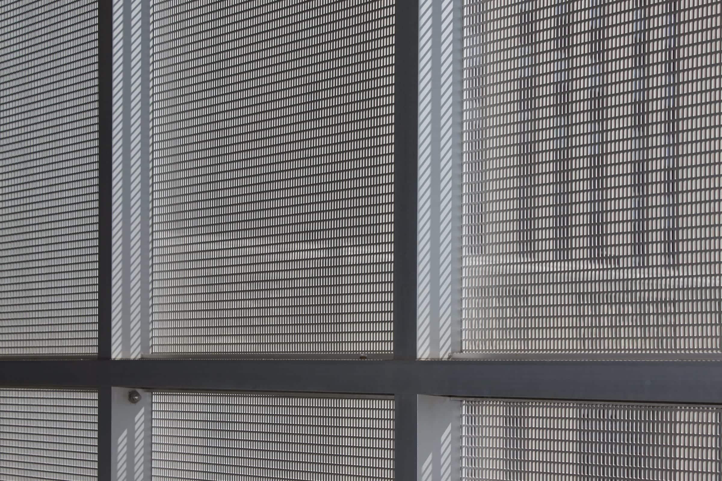 Interior mullion attachment for the perforated metal aluminum panels.