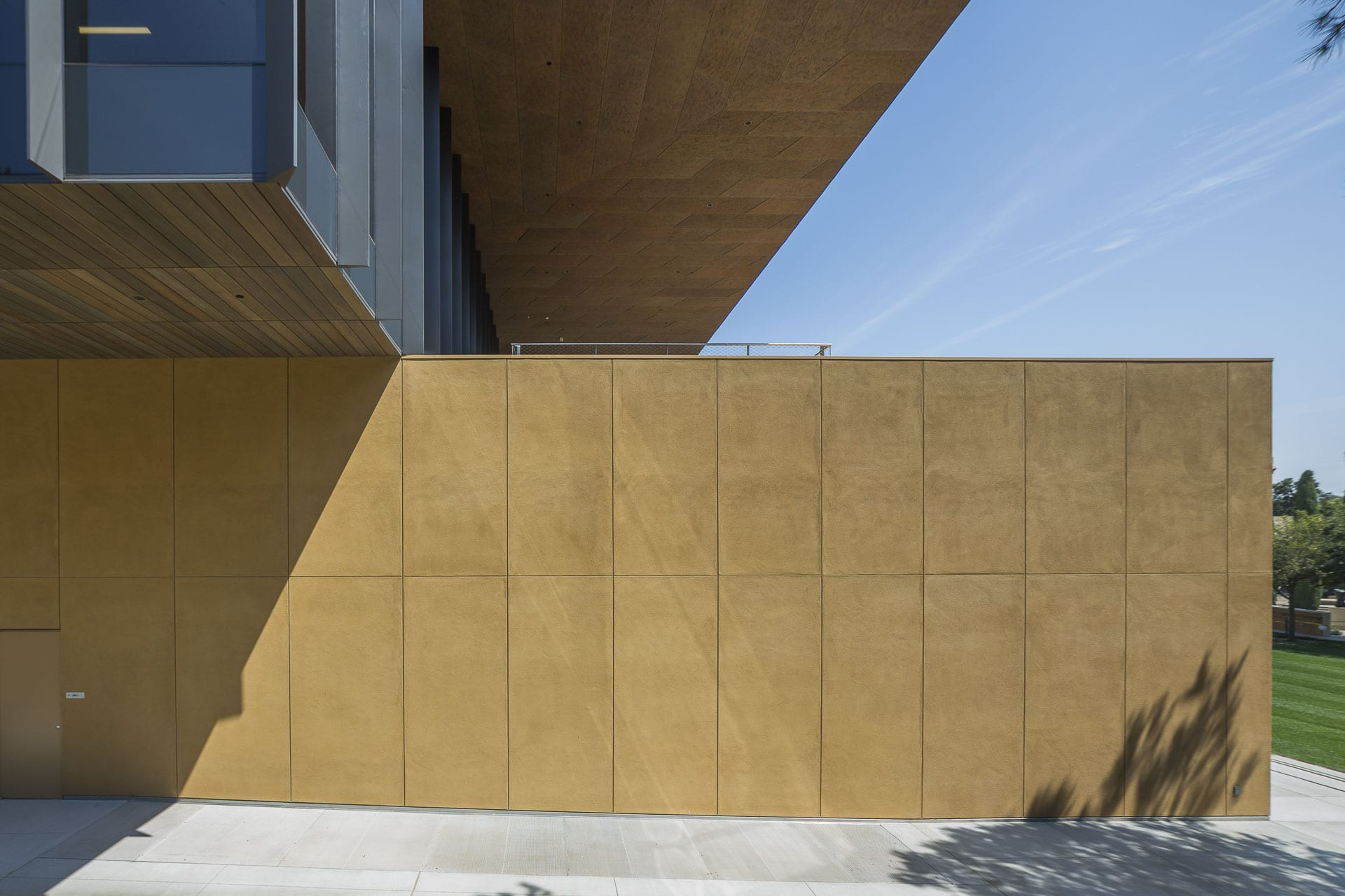 The soffit area is detailed with a preweatehred custom zinc with custom panel-patterns.