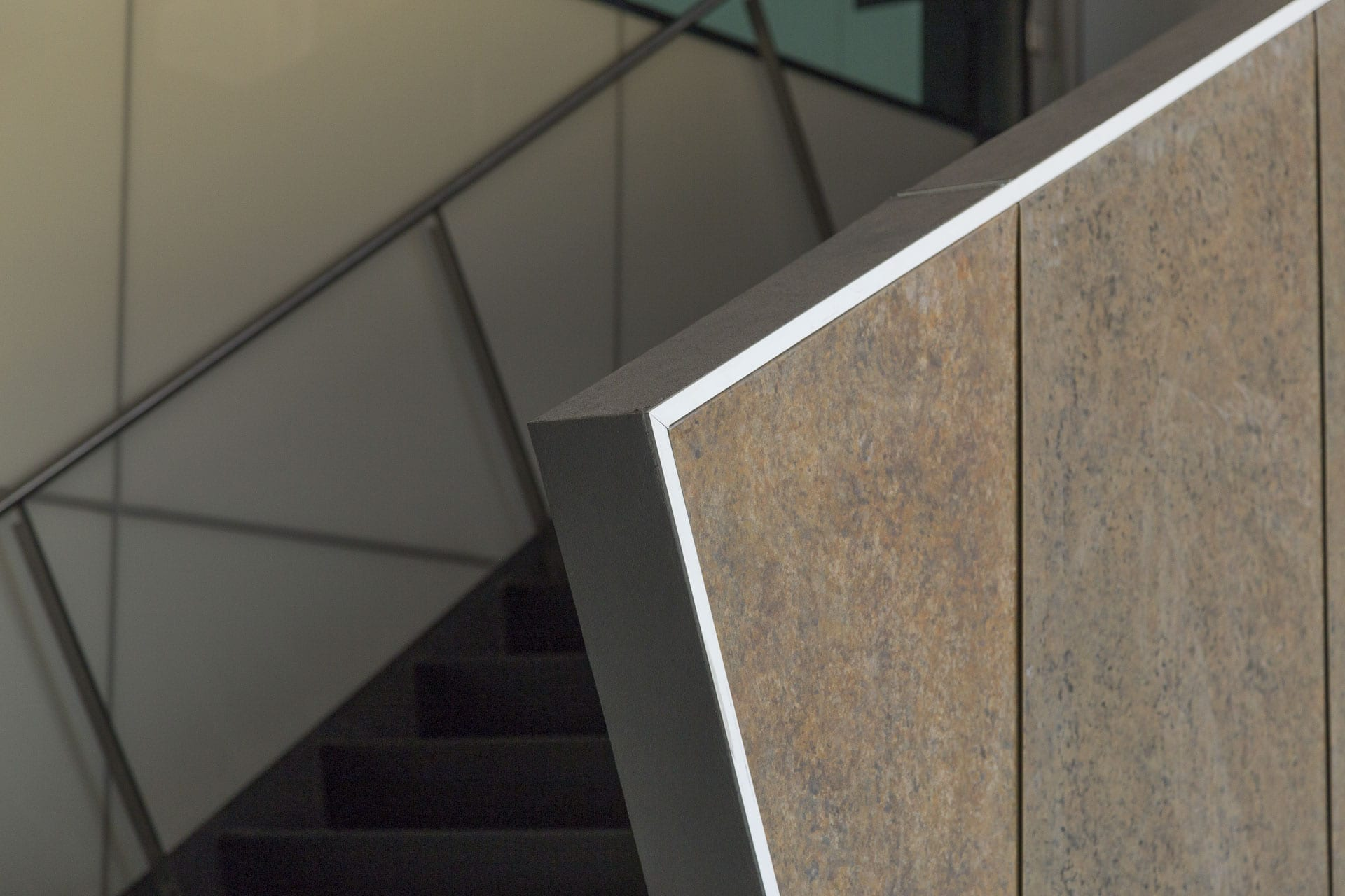 Detail of the custom zinc interior atrium staircase at the McMurtry Building in Stanford, California.