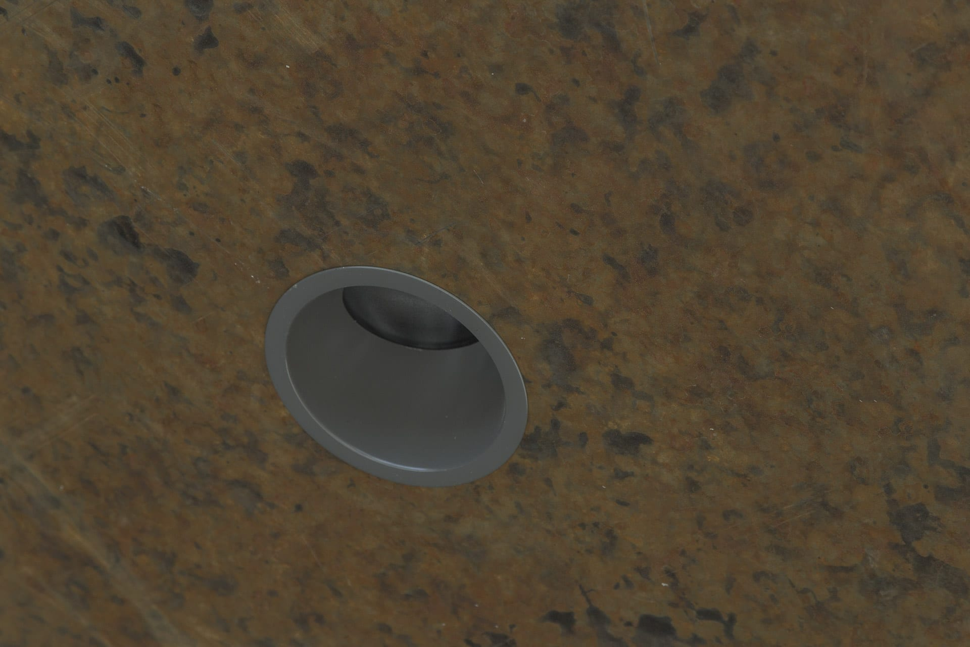 Detail of the zinc ceiling soffit and recessed lighting.