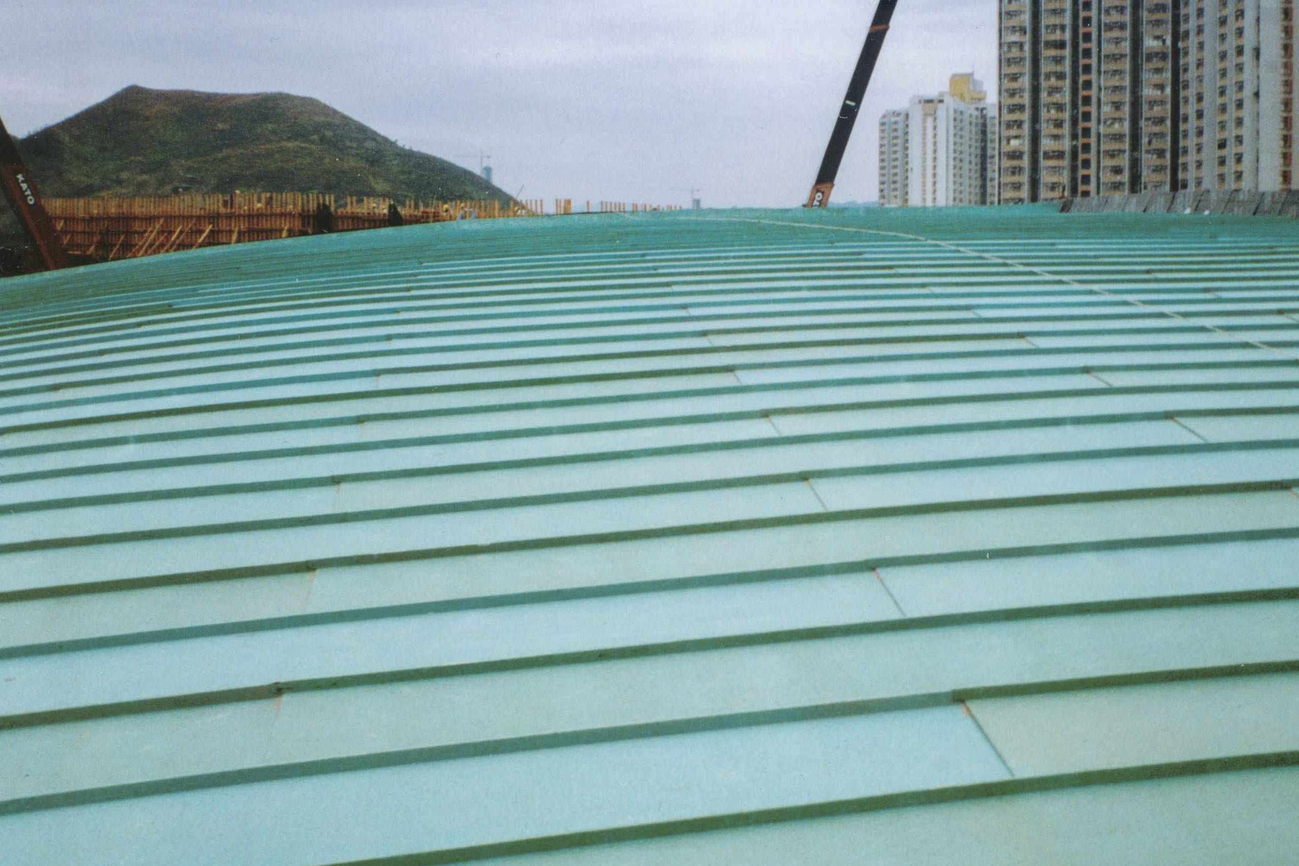 Tsing Yi Station Terminal Roof, running bond pattern on double-lock standing seam roof.