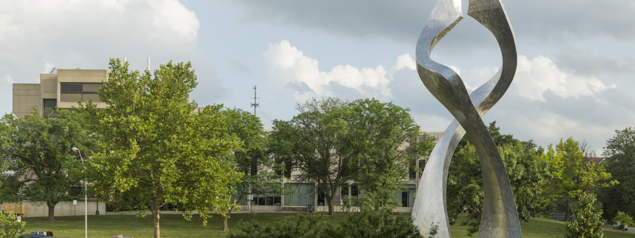 The stainless steel artwork rises 32' and sits on a base of the same material.