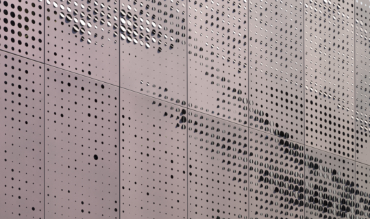 Detail: Zahner patented Louvered ZIRA perforated panels. Color-shifting paint by Valspar.
