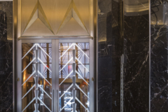 Custom transom medallions and doors for Walker Tower.