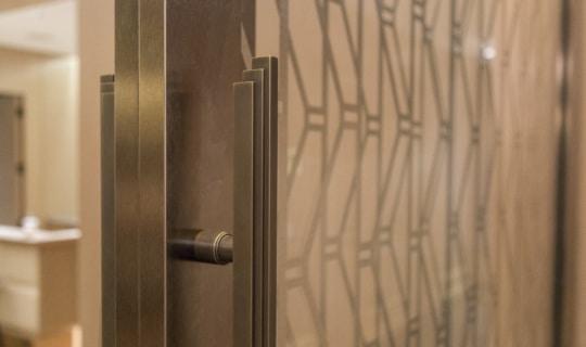 Detail of the bronze door hardware for the custom sliding lounge.