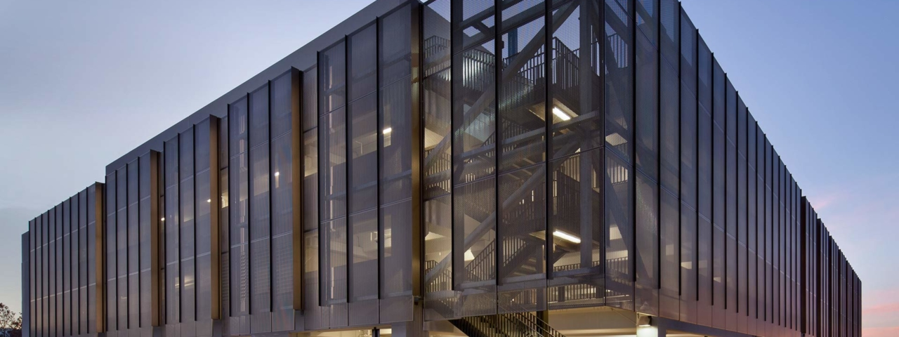 The perforated metal panel screen system at Stanford University Parking Garage.