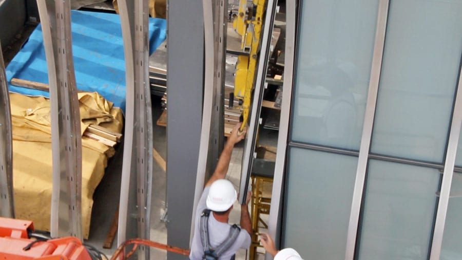 Zahner Installers install the glass panels.