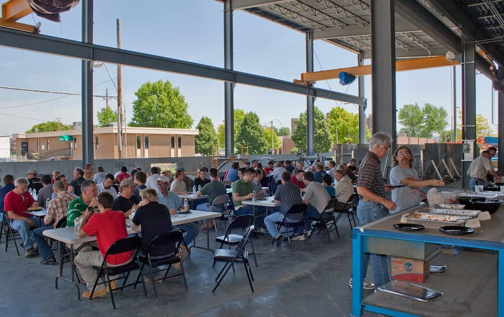 Zahner employees have a safety lunch in the shop prior to the Cloudwall Installation.