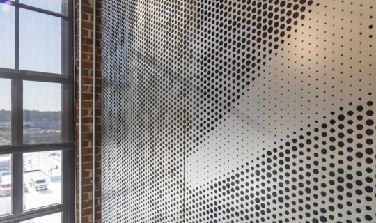 Free-standing screen in Angel Hair Stainless Steel with a painted aluminum backing for office lobby.