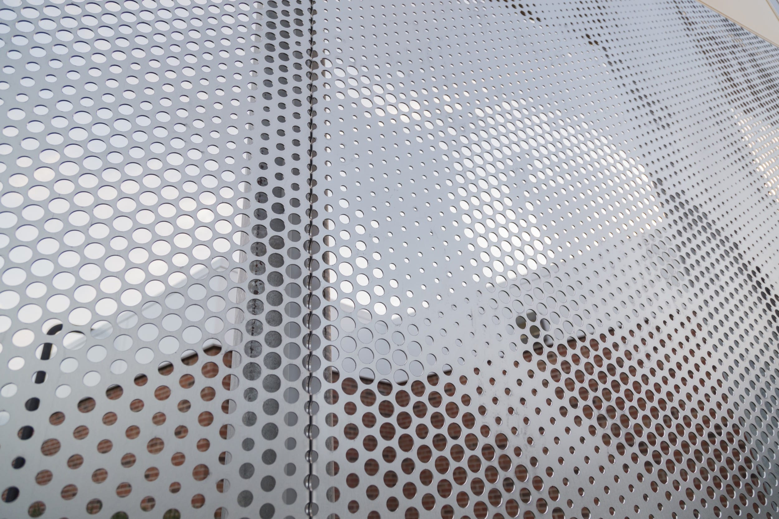 Angel hair stainless steel screens depicting the school's mascot.